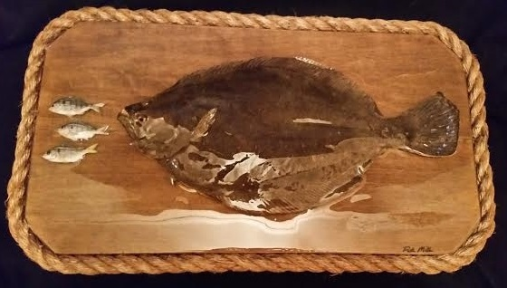 taxidermied flounder and pin fish wall art piece.